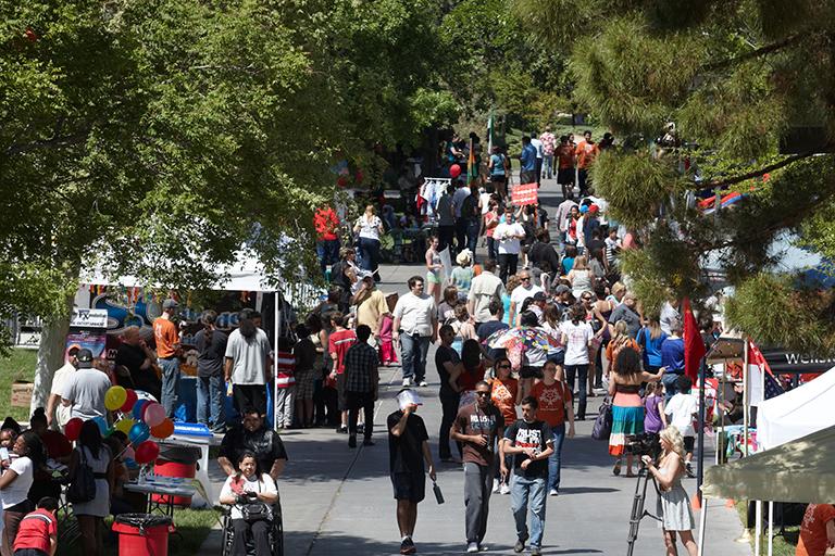 Multiple people walking on campus