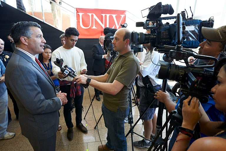 "alt=""News crew interviewing a public figure on U-N-L-V campus."""