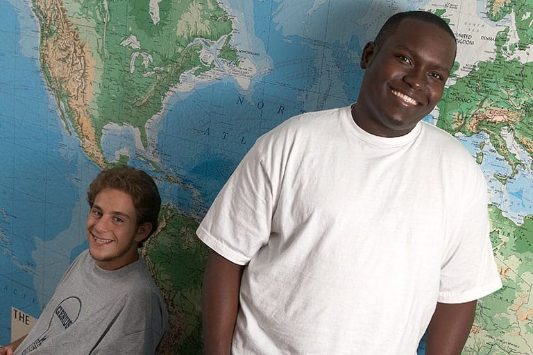 "alt=""Students in front of a map"""