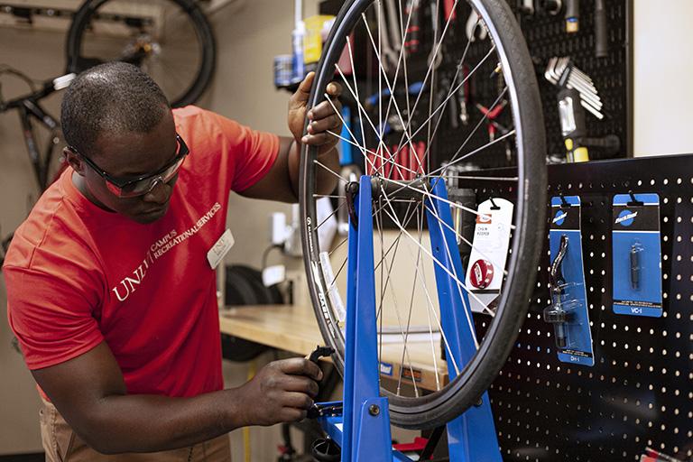 A man working on a bike.