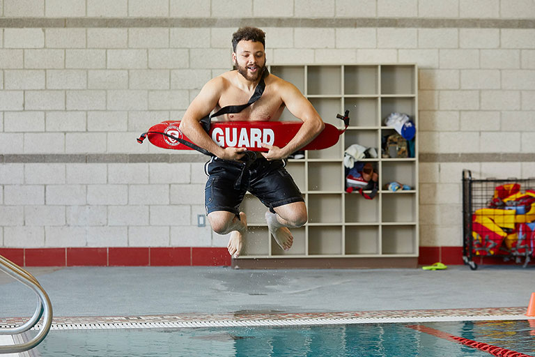 Athlete jumping into the pool