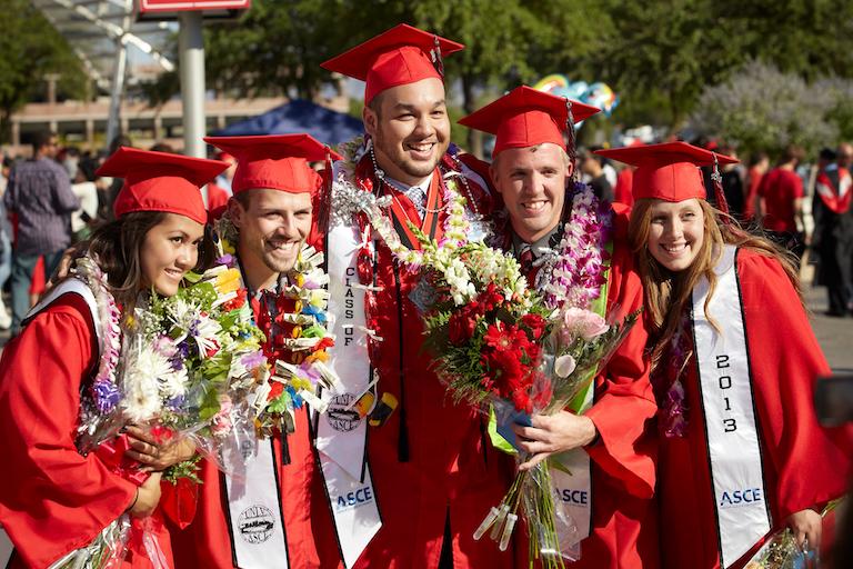 Graduates pose for a photo