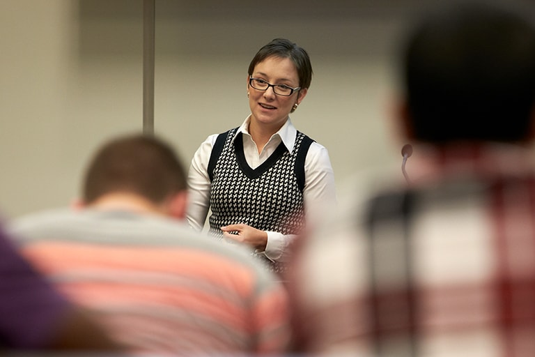 Faculty member teaching in front of class