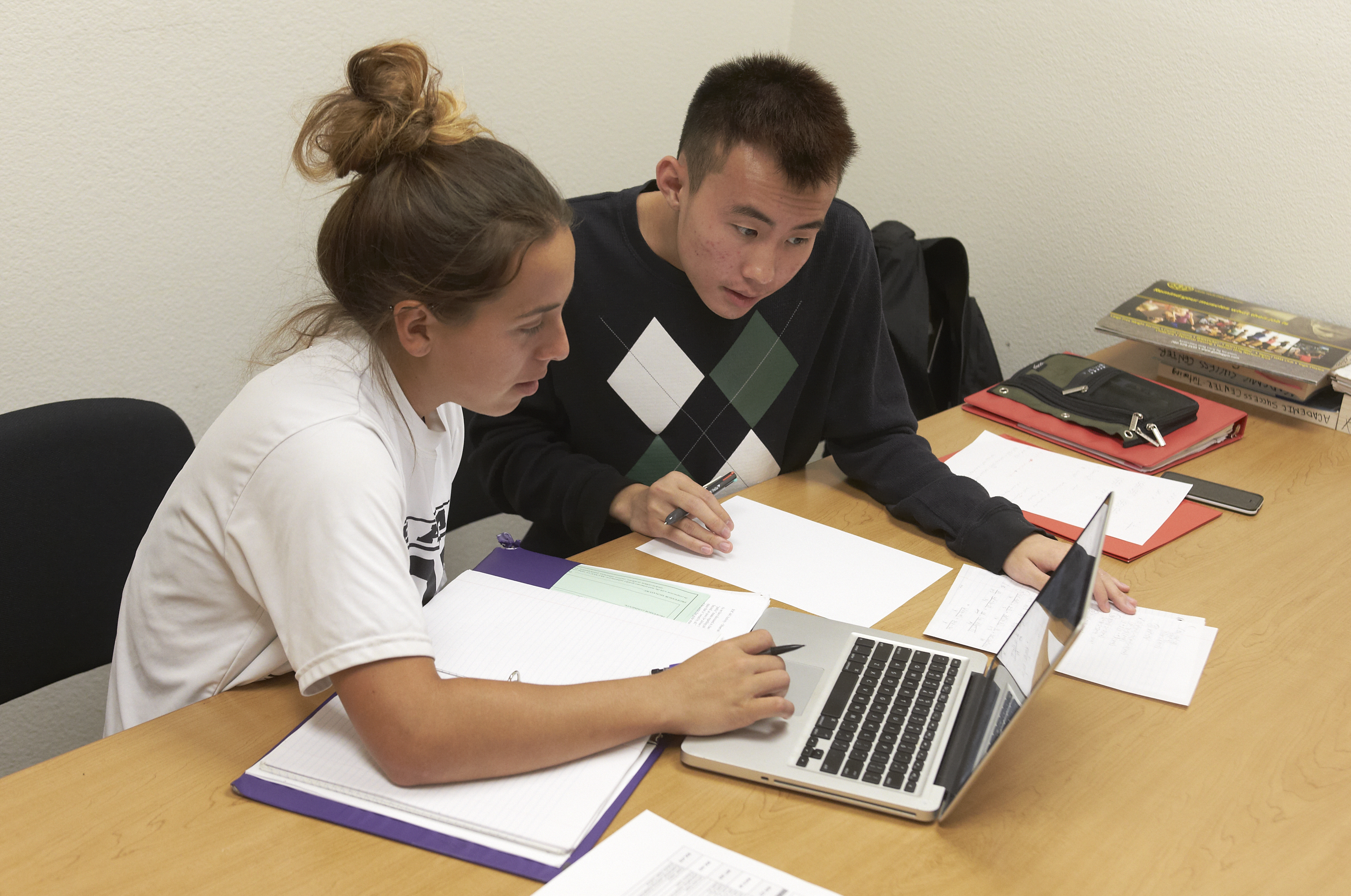 Two people studying with laptop