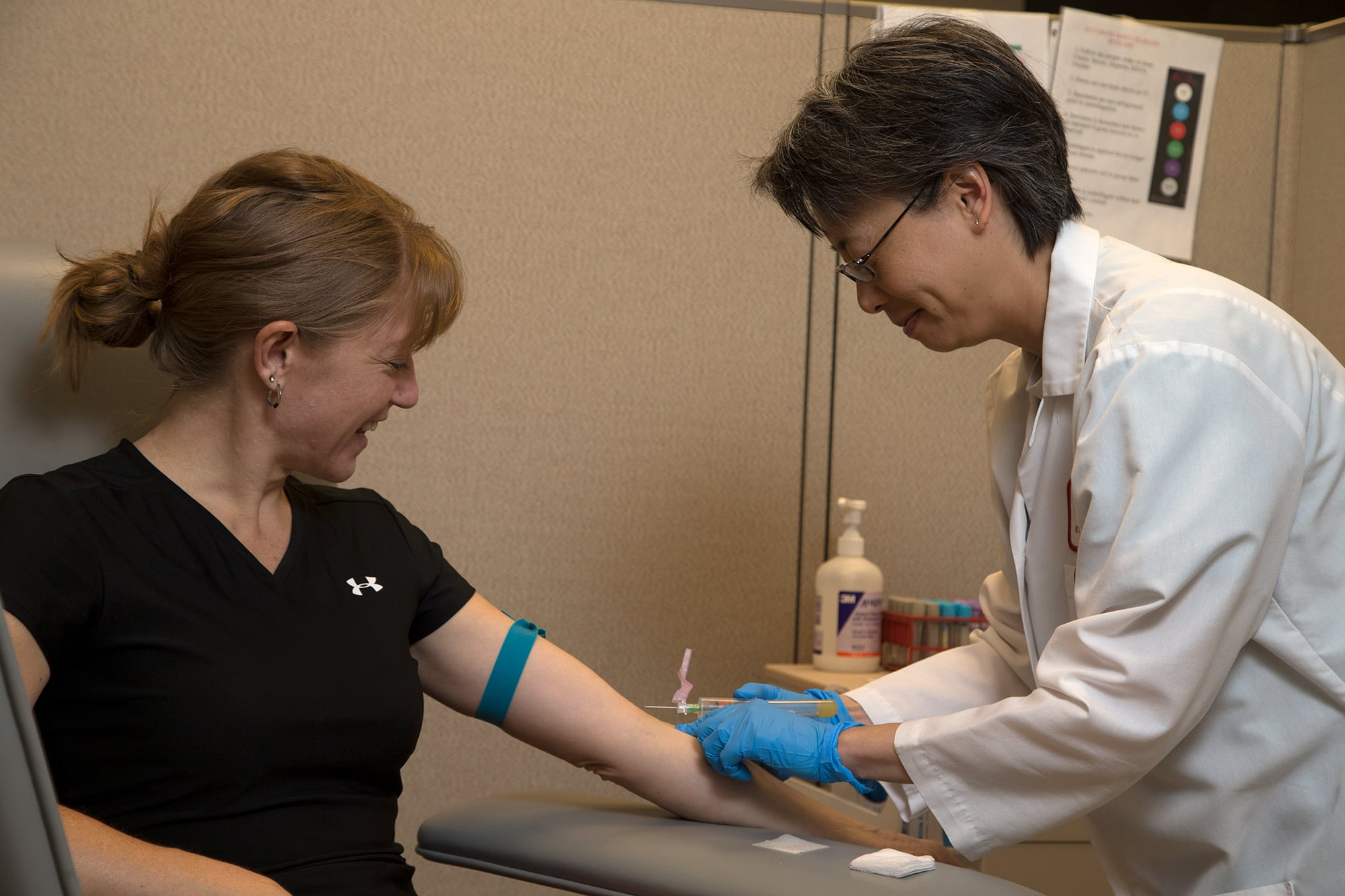 A patient at an appointment giving blood for labs.