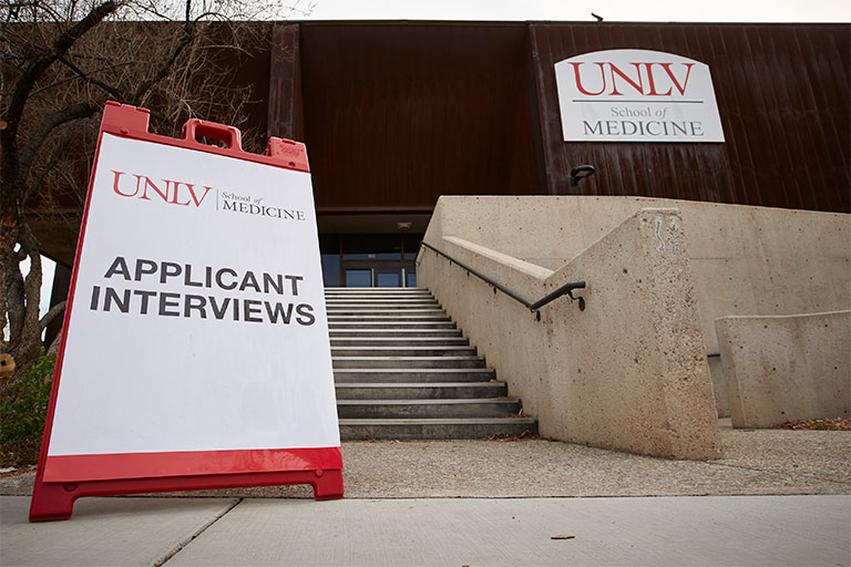Applicant interview sign in front of the School of Medicine offices at the Shadow Lane Campus