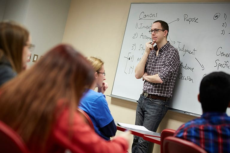Professor teaching students in a classroom