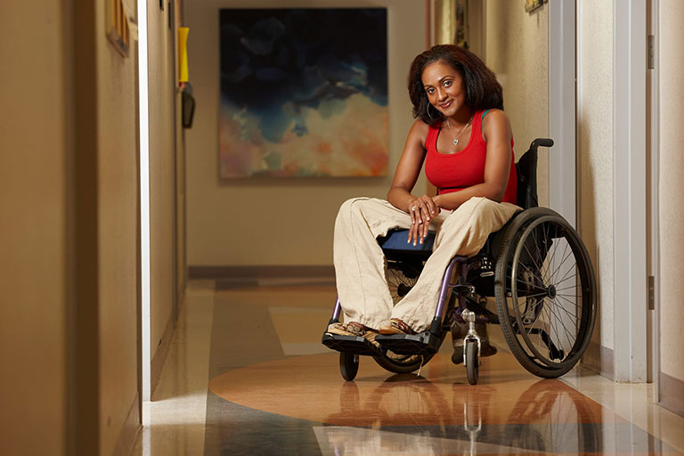 Woman smiling on a wheelchair