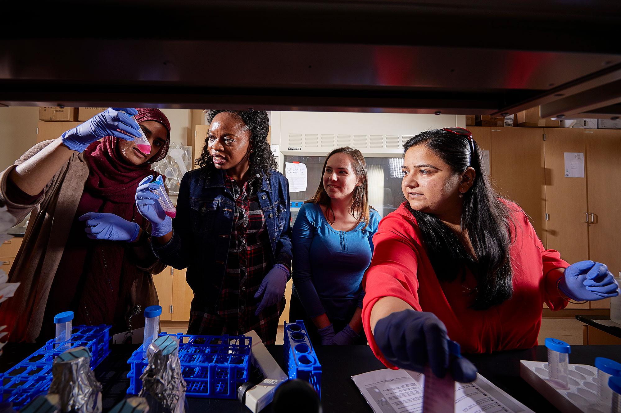 Women conducting an experiment.
