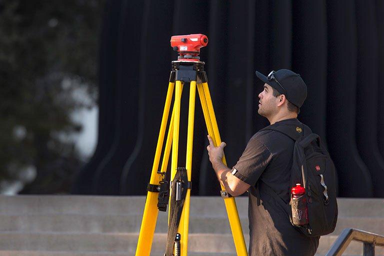 A man setting up equipment.