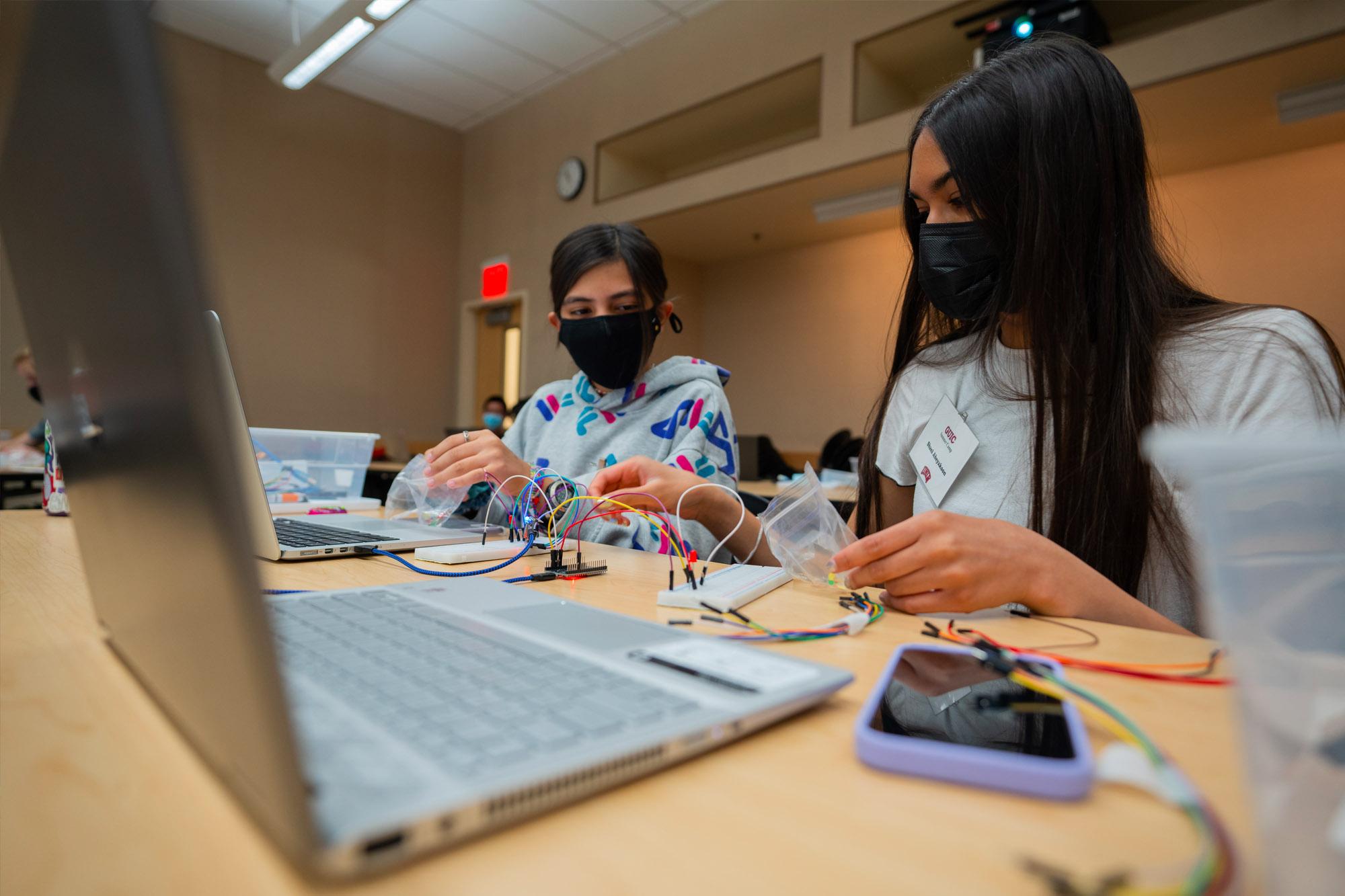 Girls working on electronics