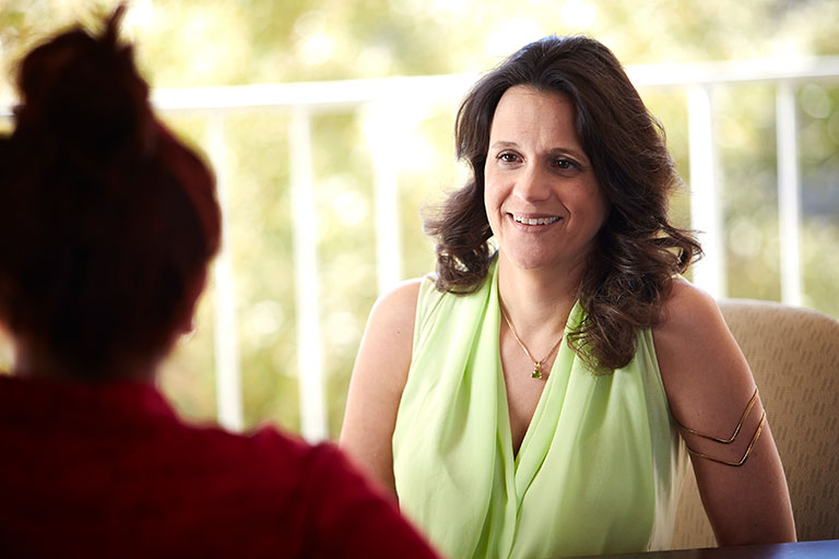 Katherine Hertlein, Professor of Marriage and Family Therapy Program, smiling to someone