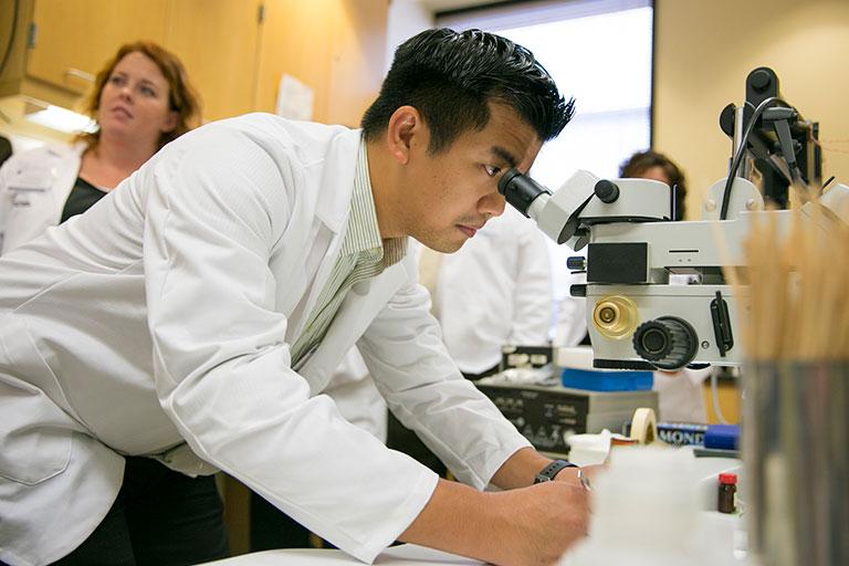 A man using a microscope
