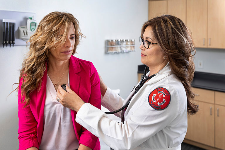 A doctor examining a patient.