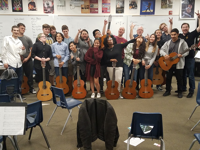 A group of students holding guitars