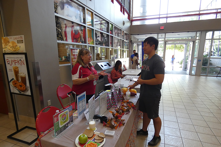 A student speaking with a R.W.Z. counselor in the Student Union.