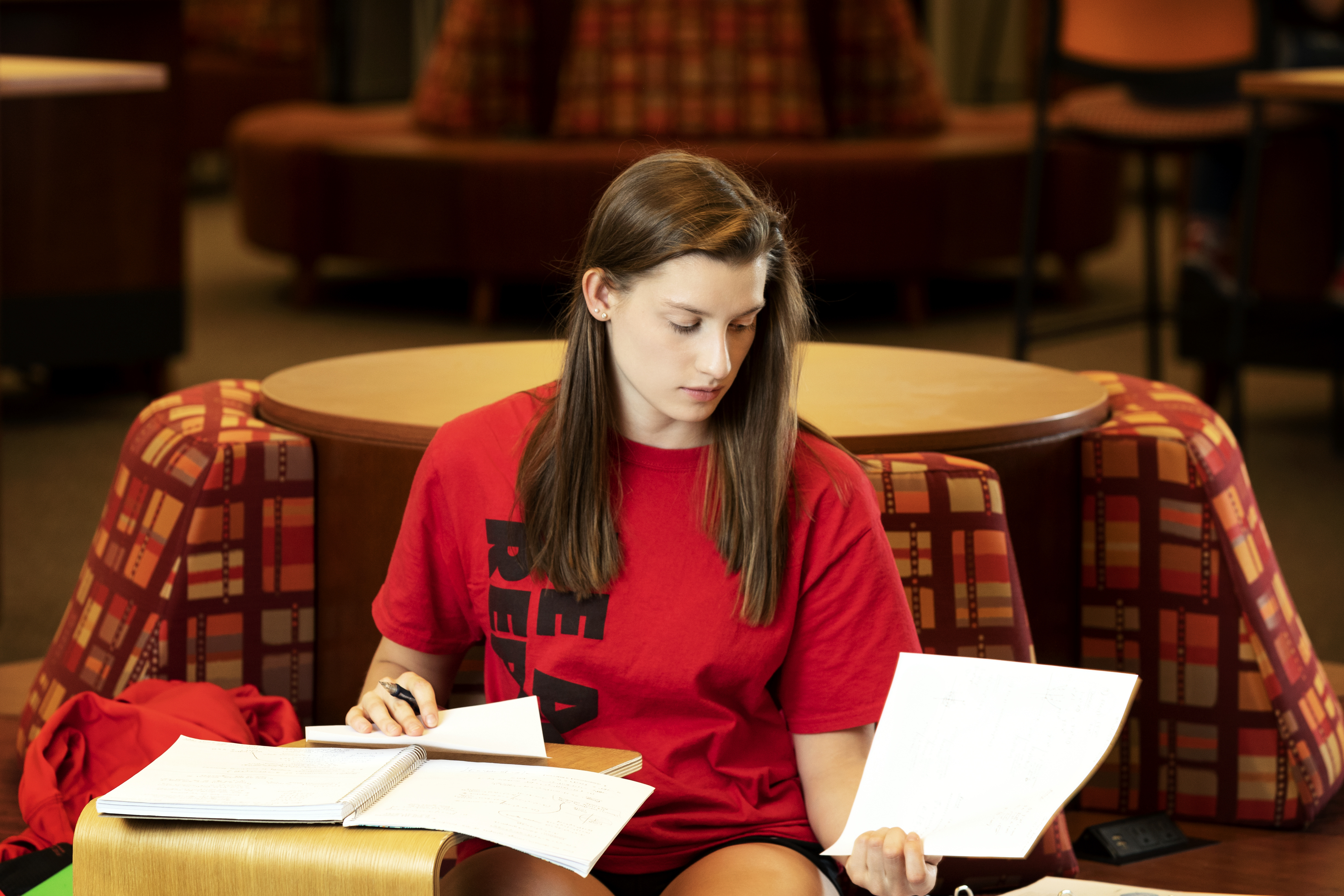 Woman studying with notes