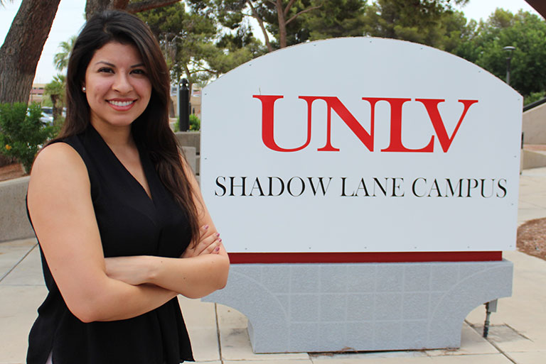 Woman standing in front of UNLV Shadow Lane Campus sign