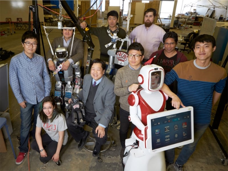 Group of students with robots