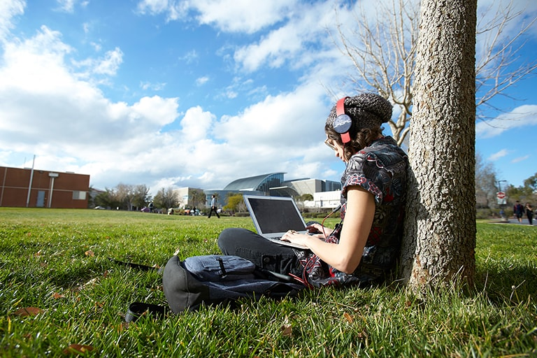 Student sitting on the grass.