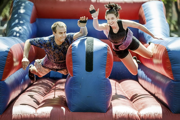 Two students on an obstacle course.