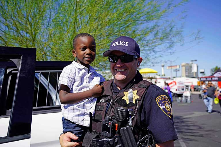 Officer holds child