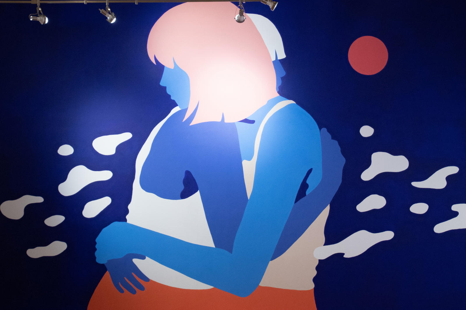 An painting of two people hugging each other