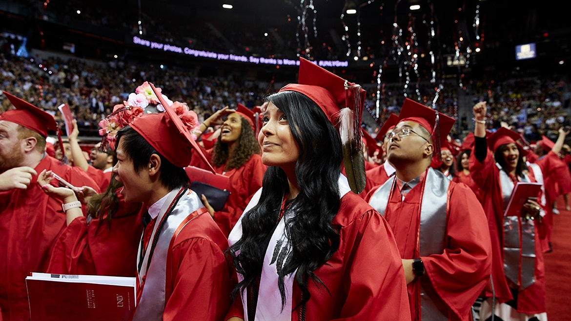 graduates look up during commencement celebration