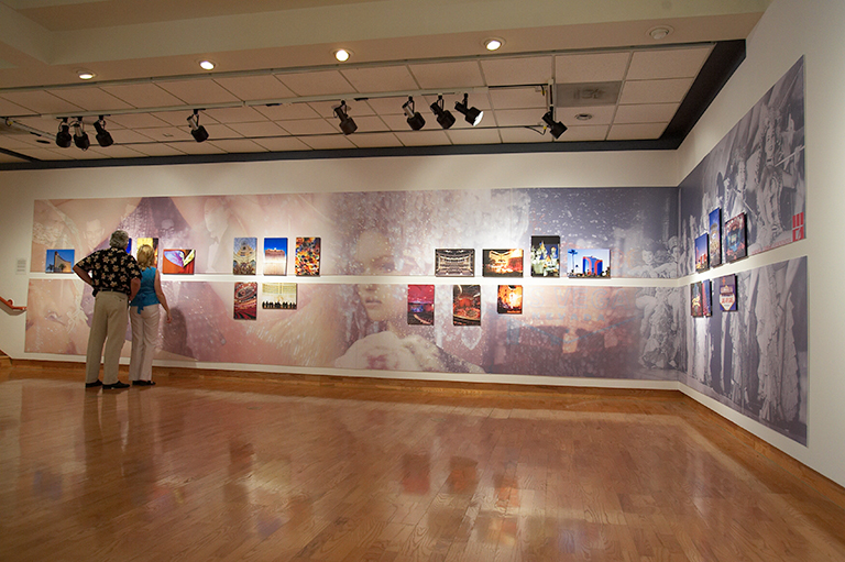 A variety of paintings hanging on the walls of the Donna Beam Fine Art Gallery.