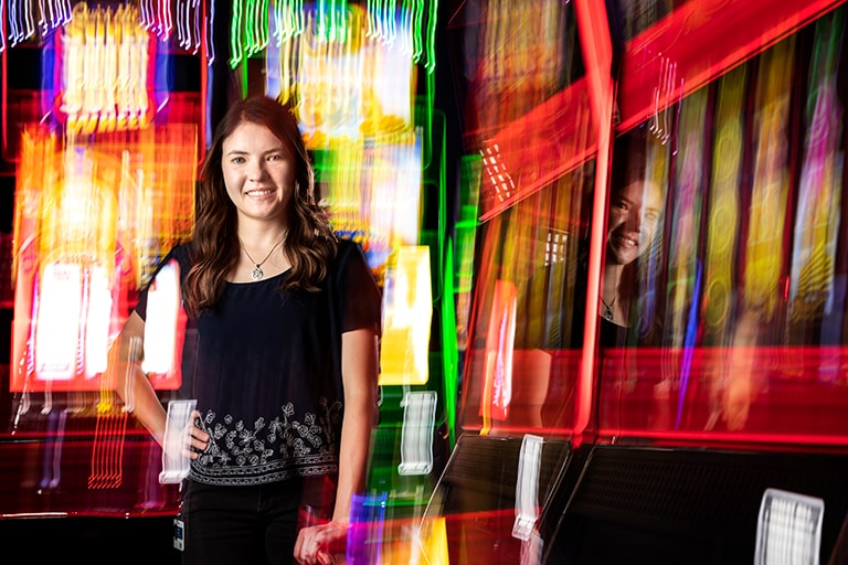 Tabitha Engle poses in front of slot machines