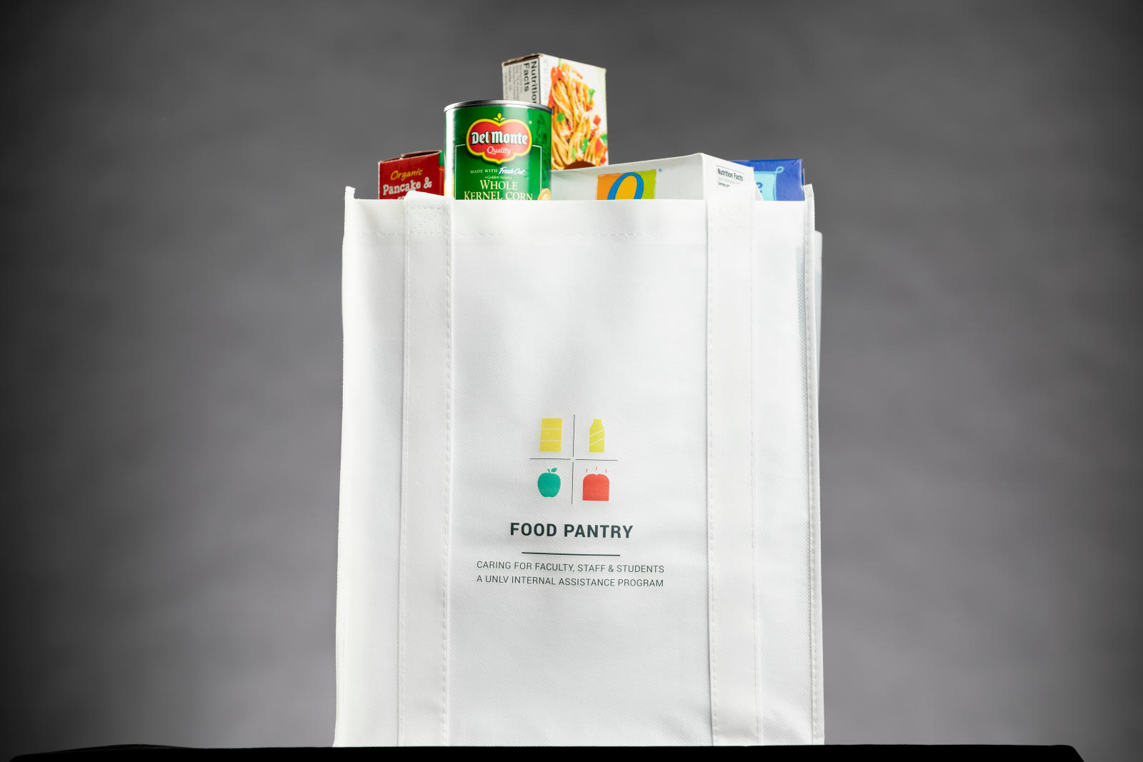A grocery bag full of food.