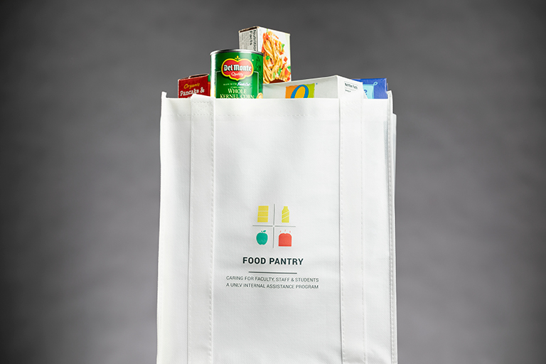 white paper bag full of food