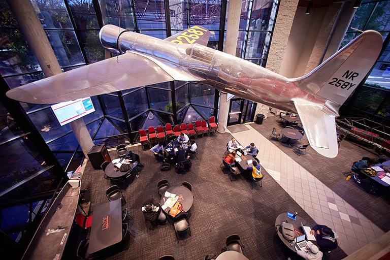 Airplane hangs in building lobby