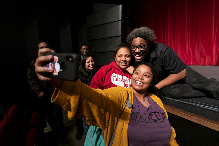 Students take selfie with W. Kamau Bell