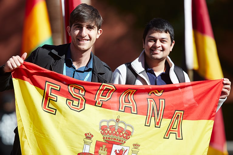 Two students old a Spanish flag