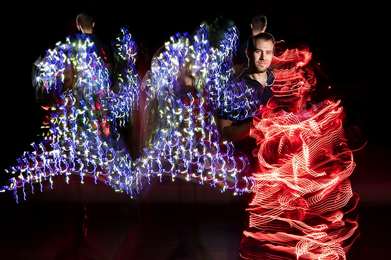 Jeremy Knowles poses with clothes that use L.E.D. lights