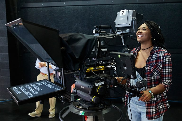 Student operates a television camera
