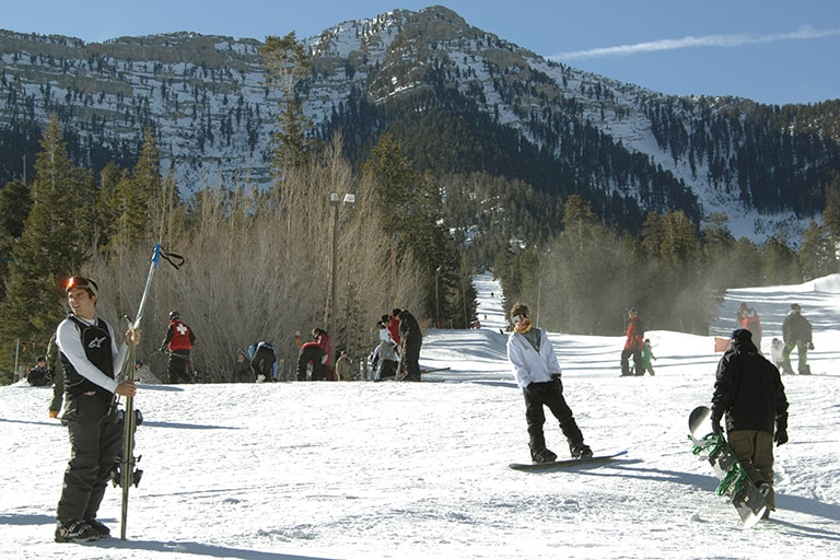 Several snowboarders on snowy mountain