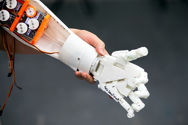 Closup of white robot forearm and hand