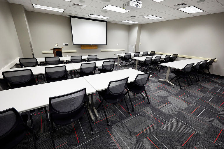 An empty classroom is pictured