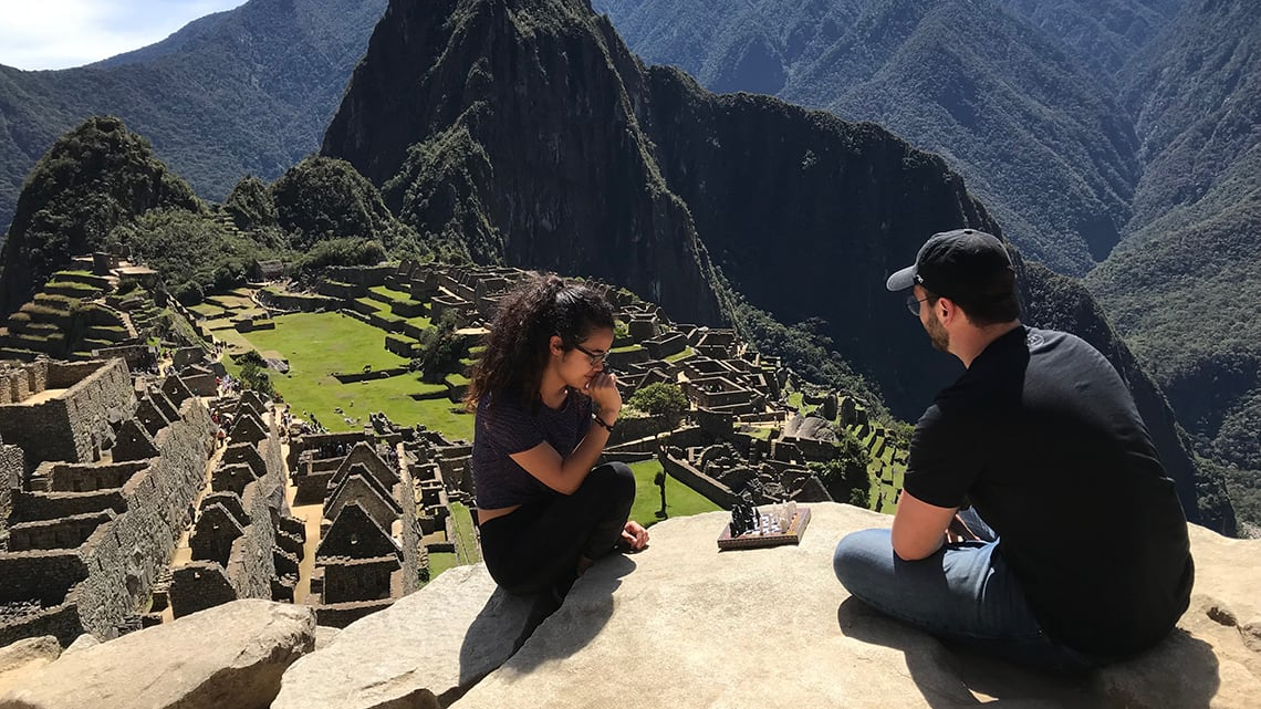 Two students play chess with on Peru mountaintop