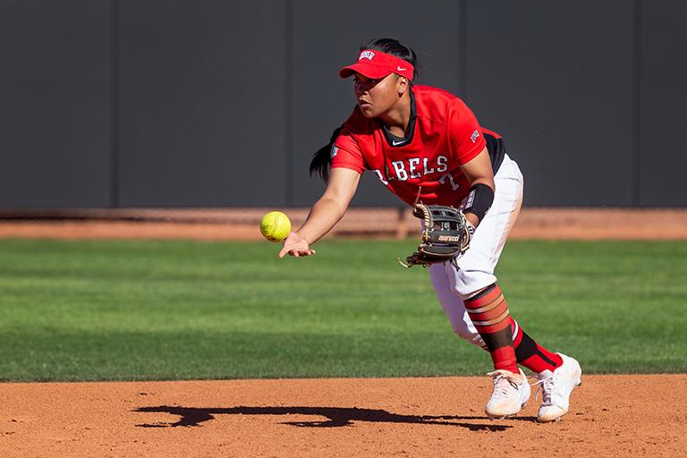 student pitching softball