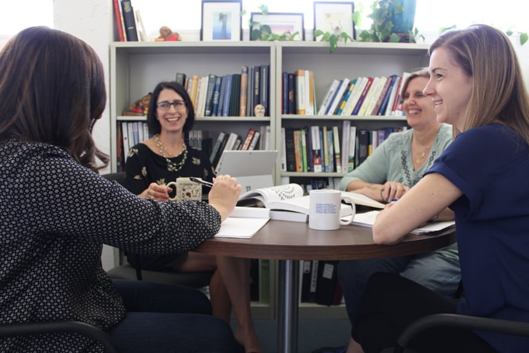 Center for Research, Evaluation, and Assessment team members discuss a project in May 2017