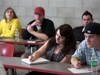 Students taking notes in class.