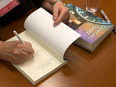 An author signing their book.