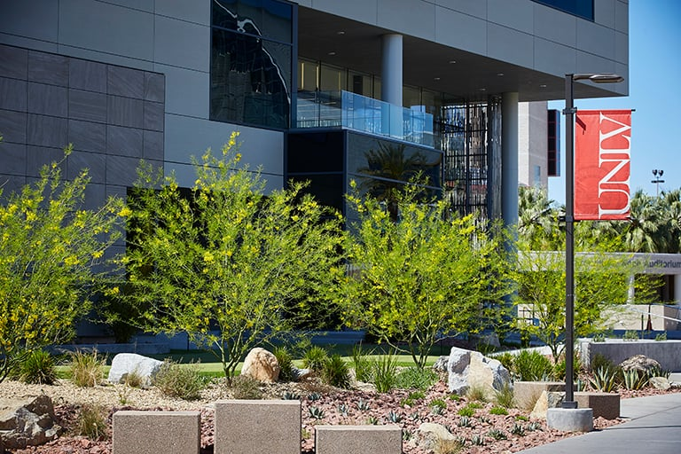 A picture of UNLV campus with Hospitality Hall in the foreground.