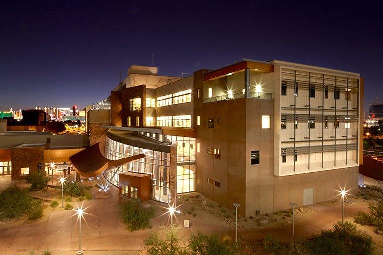 View of the SEB Building at night.