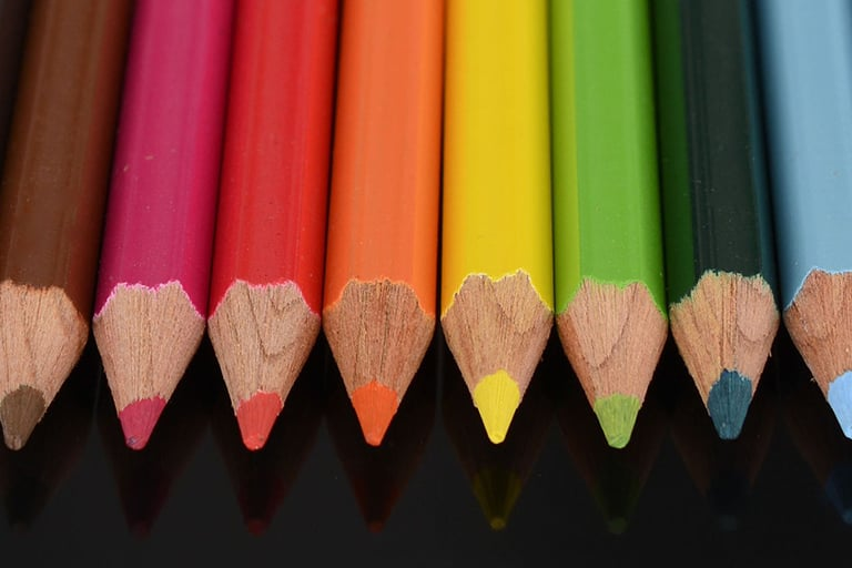 An assortment of colored pencils, cover photo for Rebel Educators