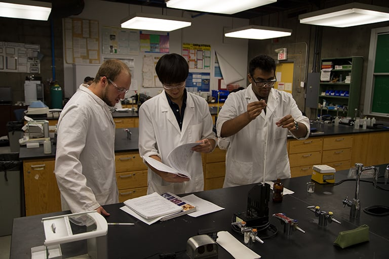 Students in class doing lab work.