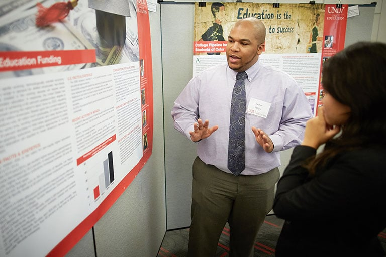 College of Education student doing poster presentations at a general undergraduate research fair.